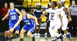 Two female players from Largo put defensive pressure on the Williamsport ball handler in the 2016 State Finals.