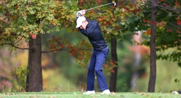 A male golfer tees off at the 2015 State Golf Tournament.