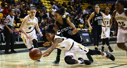 A Frederick player dives for a loose ball during the 2017 Girls State Basketball Tournament.