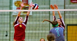 A Patuxent spiker hits the ball between two Hereford blockers at the net during the 2015 State Semifinals.