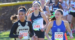 Female runners in the Class 4A race head into a turn during the 2016 State Championships.