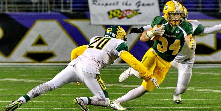 A Damascus running back tries to elude the tackle of a Dundalk defender in the 2015 Class 3A State F