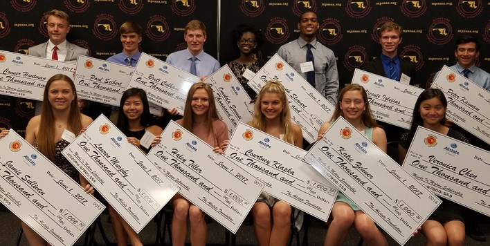 Photo of all of the 2017 Minds In Motion Scholarship winners holding their oversized checks.