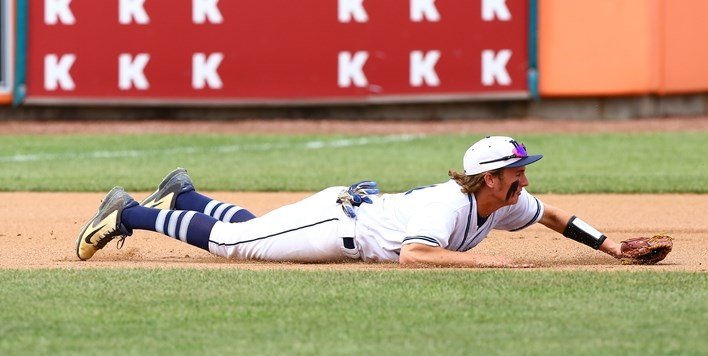 A La Plata fielder dives to make a play against Williamsport in the 2016 State Baseball Finals.