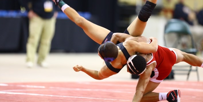 One wrestler executes a takedown on another wrestler in the 2016 State Tournament.