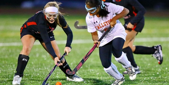 A North Carroll defender tries to take the ball away from a Fallston attack player in the 2015 State