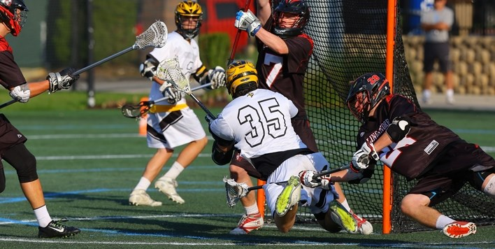 A Mount Hebron attackman goes to the ground at the crease in an attempt to score against Linganore.