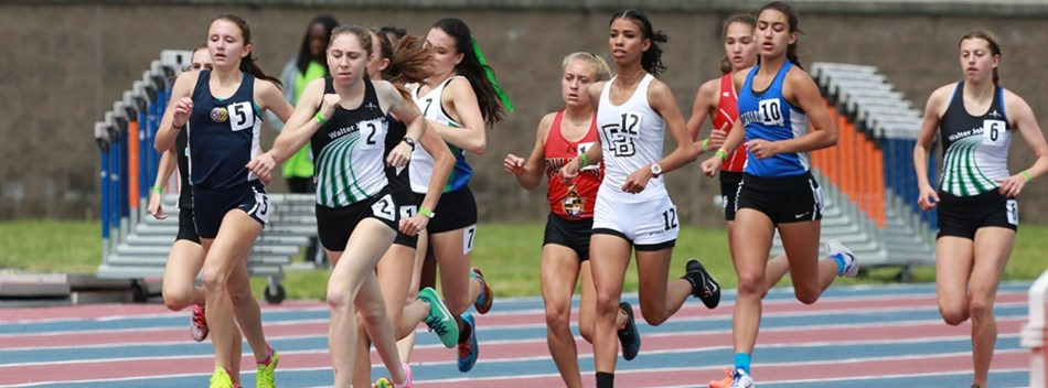 A girls distance race at the 2017 State Track and Field Championships.