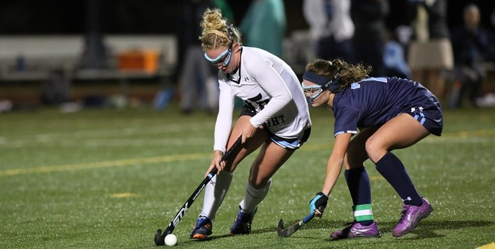 A defender applies defensive pressure to the attacker during the 2017 State Field Hockey Tournament.