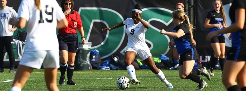 A Patterson Mill female controls the soccer ball in front of a Sparrows Point HS defender.