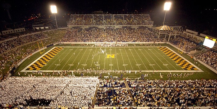 Night game photo of Navy-Marine Corps Memorial Stadium in Annapolis with large crowd.