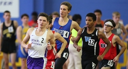 Male distance runners head into the turn at the PG Sportsplex at the 2018 State Championships.