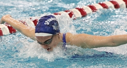 A female swimmer competes in the butterfly at the 2018 State Championship Meets.