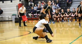 A libero prepares to dig the ball at the 2018 State Volleyball Tournament.