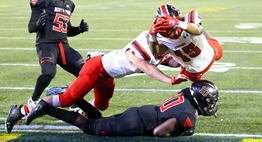A Quince Orchard player dives over the goal line for a touchdown against North Point in the 2018 Class 4A Final.