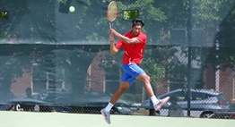 A male singles player hits a two-handed backhand return in the 2018 State Tennis Tournament.