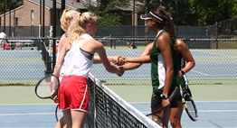 Two Girls Doubles team shake ends at the net after a match in the 2018 State Tournament.