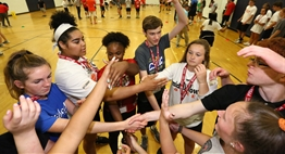 Student-athletes participate in a team building activity at the 2018 Leadership Conference.