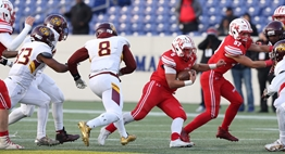 A Fort Hill football player follows his blockers through the Dunbar defense during the 2017 Class 1A State Finals.