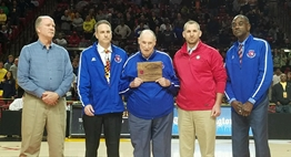 Charles Hudson receiving his service award from MPSSAA officials and State Basketball Committee.