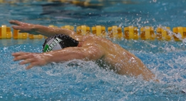 A male swimmer competes in a butterfly race at the 2017 State Championships.