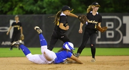 In the 2017 2A State Softball Final, a North Caroline baserunner dives headfirst back into second base avoiding the put out by the South Carroll infielders.
