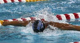 A male swimmer races in the butterfly at the 2018 State Meets.