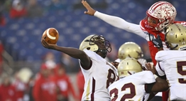 A fort Hill defender tries to block the Douglass-PG quarterbacks pass during the 2018 Class 1A State Football Finals.