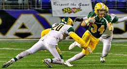 A Damascus running back tries to elude the tackle of a Dundalk defender in the 2015 Class 3A State Final.