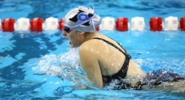 A female swimmer from Huntingtown HS swims breaststroke in the 2016 State Championships.