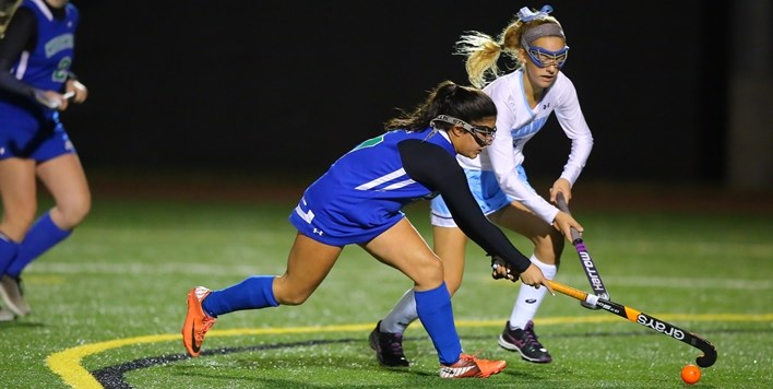 Two field hockey players battle for control of the ball during the 2016 State Finals.