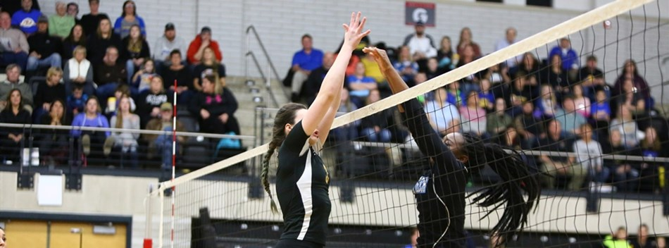 A Western Tech and Clear Spring player play above the net in the 2018 Class 1A State Volleyball Fina