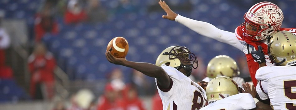 The Douglass-PG quarterback attempts a pass against Fort Hill in the Class 1A State Final.