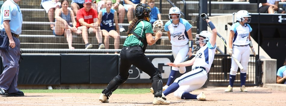 A baserunner slides home safely ahead of the throw in the 2019 Class 2A State Softball Final.