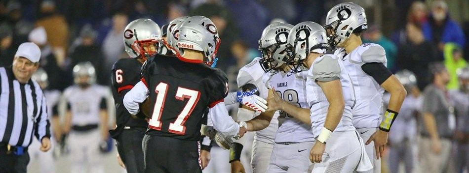 The Glenelg and Oakdale team captains shake hands before the 2018 Class 2A State Football Final.