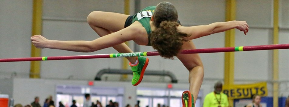 A female high jumper clears the bar in the 2018 State Indoor Track & Field Championships.