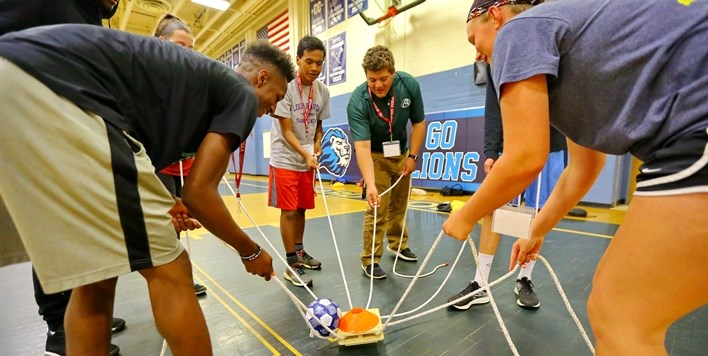 Student-athletes participate in a team building exercise during the 2017 Leadership Conference.