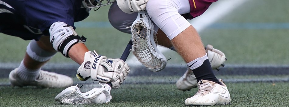 A ground level close-up of a face-off during the 2018 Class 2A State Boys Lacrosse Final.