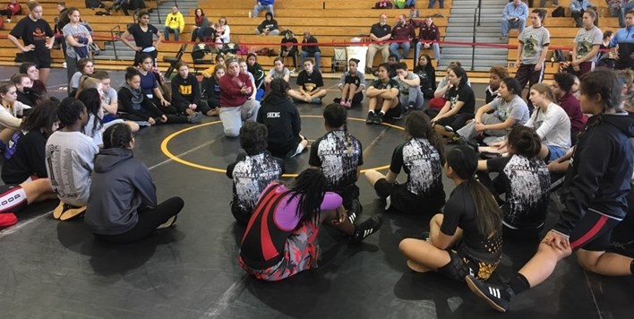 Clinic attendees watch carefully during the clinic portion of the 2018 Girls Wrestling Invitational.