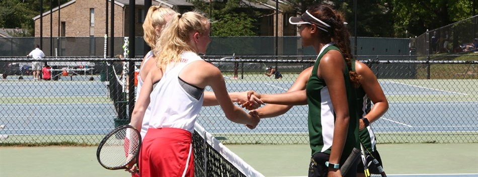 Two girls doubles teams shake hands at the end of their match at the 2018 State Tennis Tournament.