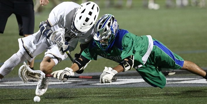 Two middies battle for control of the ball after the face-off in the 2018 Boys Lacrosse Finals.