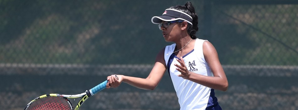 A female singles player returns a forehand shot during the 2018 State Tennis Tournament.