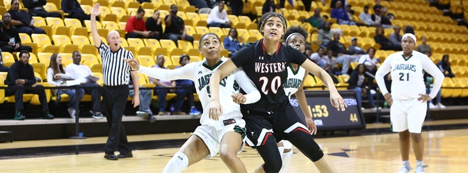 Opposing female players battle for rebounding position in the 2019 Class 4A State Semifinals.