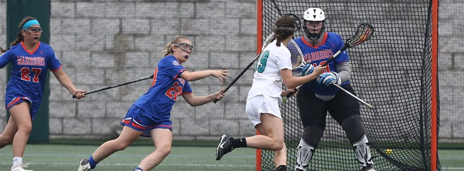 A player prepares to shoot at the goal at the 2018 Class 1A State Girls Lacrosse Final.