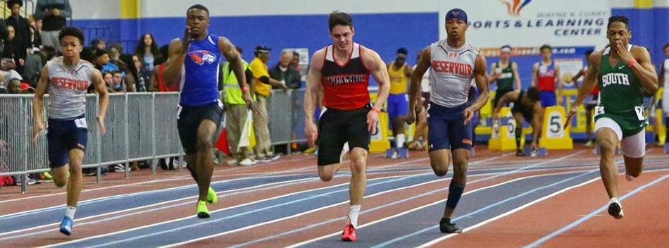 Male sprinters race down the straightaway during the 2019 Class 3A State Indoor Meet.