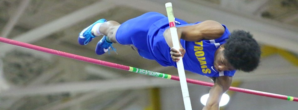 A male pole vaulter sails over the crossbar during the 2019 Class 4A State Indoor Track Meet.