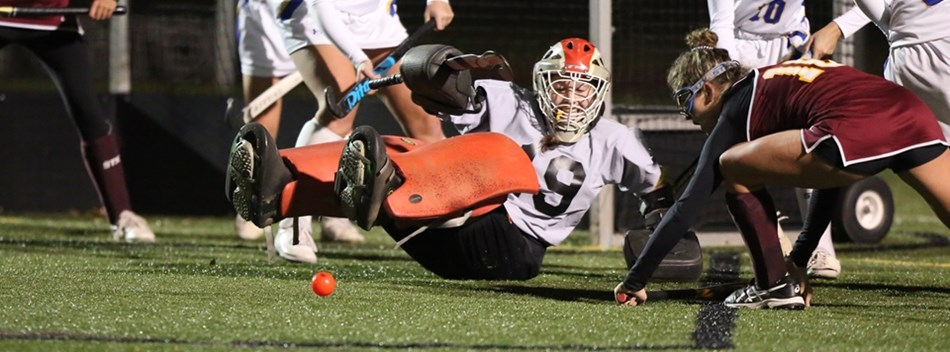 An attacker plays a rebound off of the goalie's pads in the 2018 Class 2A State Field Hockey Final.