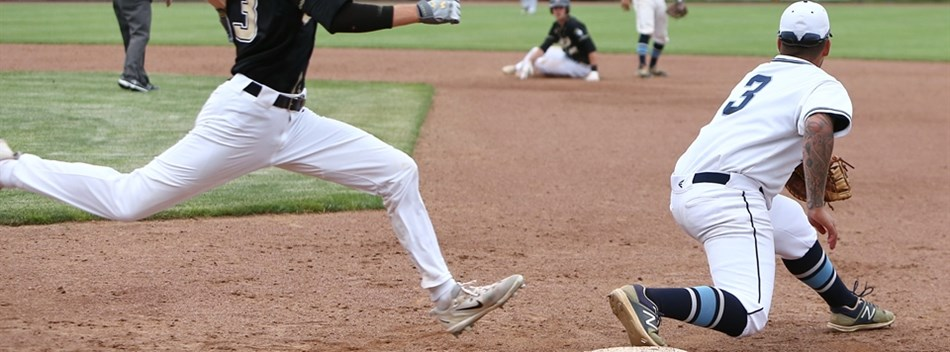 A base runner tries to beat the throw to first base on a double play during the 2018 Class 2A State