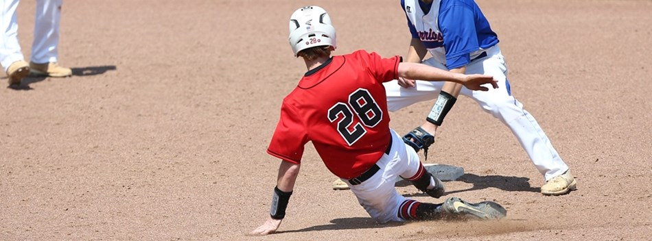 A base runner slides safely into second base during the 2018 Class 1A State Baseball Finals.
