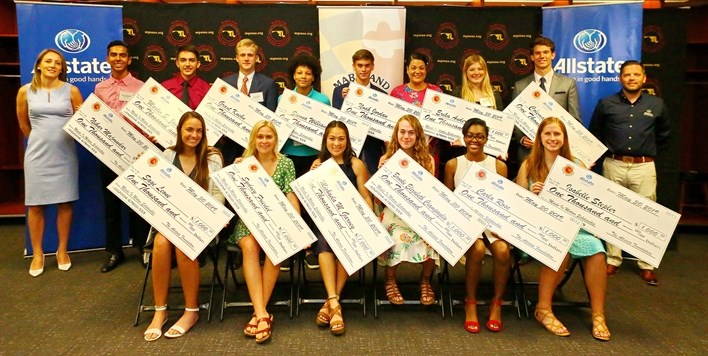 Group photo of 13 of the 14 Minds in Motion Scholarship winners along with reps from Allstate.